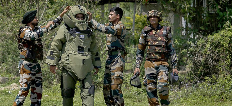 Bomb squad members at the site where IED were recovered in Assam's Tinsukia district