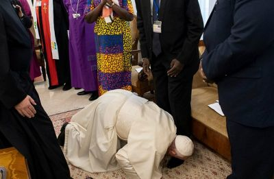 Pope kisses feet of South Sudan leaders to encourage peace, leaves them stunned