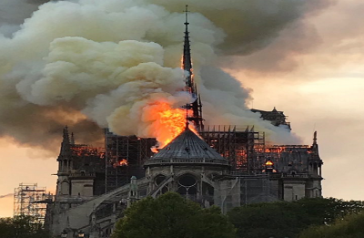 Notre-Dame Cathedral's spire collapses as massive fire ravages Paris landmark
