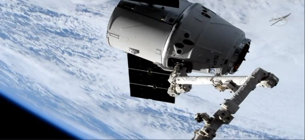 Dragon is now attached to the Space Station robotic arm (Photo Source: @SpaceX)