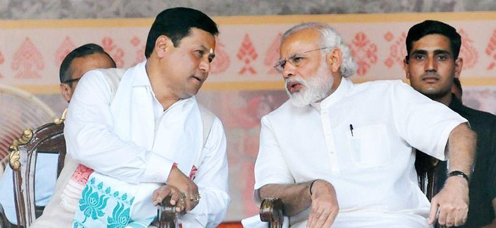 Assam Chief Minister Sarbananda Sonowal with Prime Minister Narendra Modi. (File Photo: PTI)