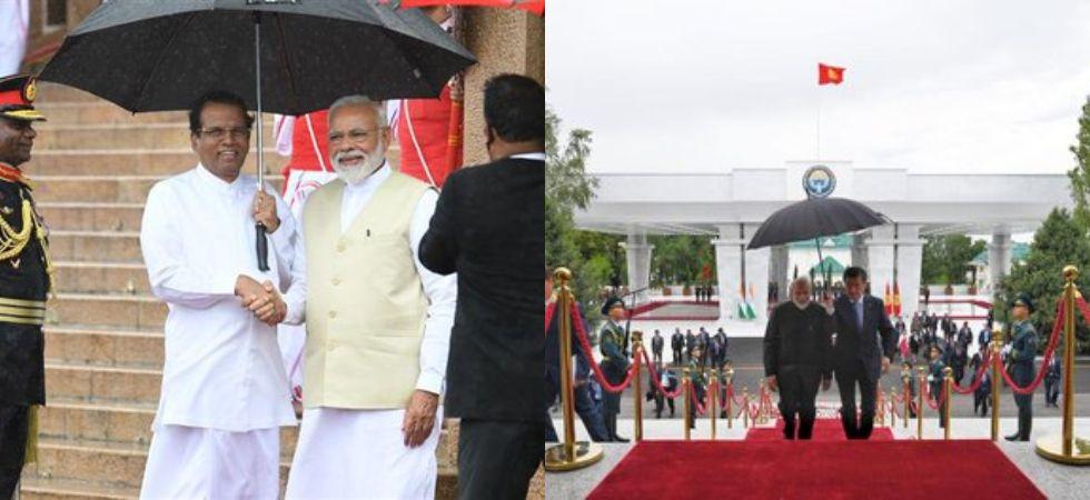 Umbrella diplomacy for PM Modi (Photo Credit: Twitter/@PBNS_India)