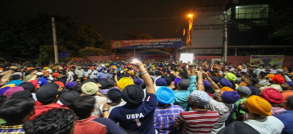 In a video from late Sunday night, an ACP-rank officer could be seen being chased by protestors outside the Mukherjee Nagar police station. He had gone there to pacify the protesters. (Photo: PTI)