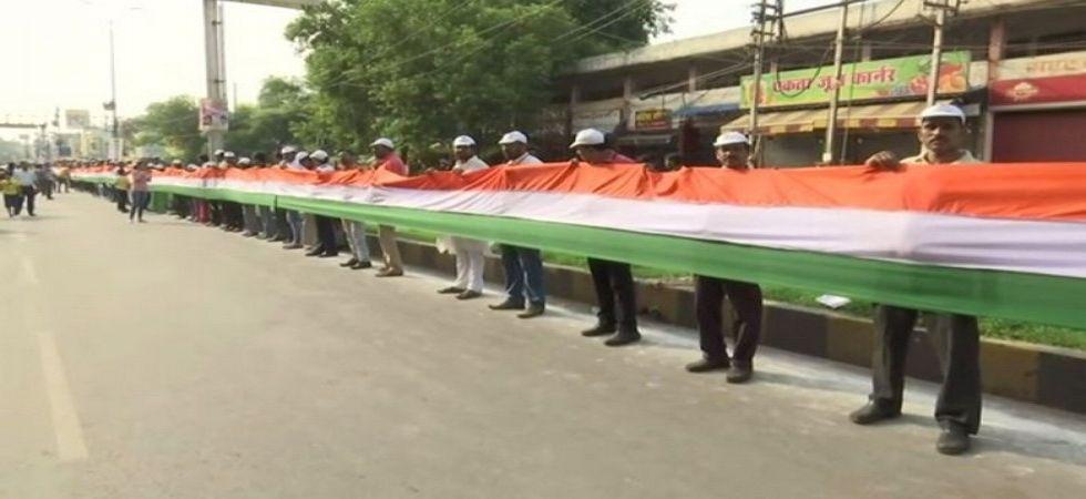 Locals form 15 Km long human chain in Chhattisgarh to unfurl Tricolor. (Image Credit: ANI)
