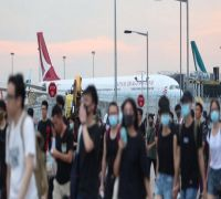 All flights out of Hong Kong cancelled as pro-democracy protesters besiege airport