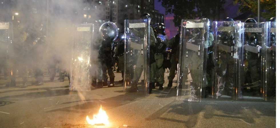 The rally quickly descended into violent clashes with riot police which stretched into the early hours of Sunday