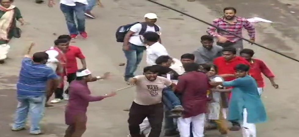 Youth and student wings of Communist Party of India (Marxist) stage a protest alleging unemployment in the state. (ANI)