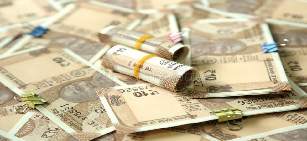 The rupee tumbled by 68 paise to 71.60 against the US currency in early trade on Monday