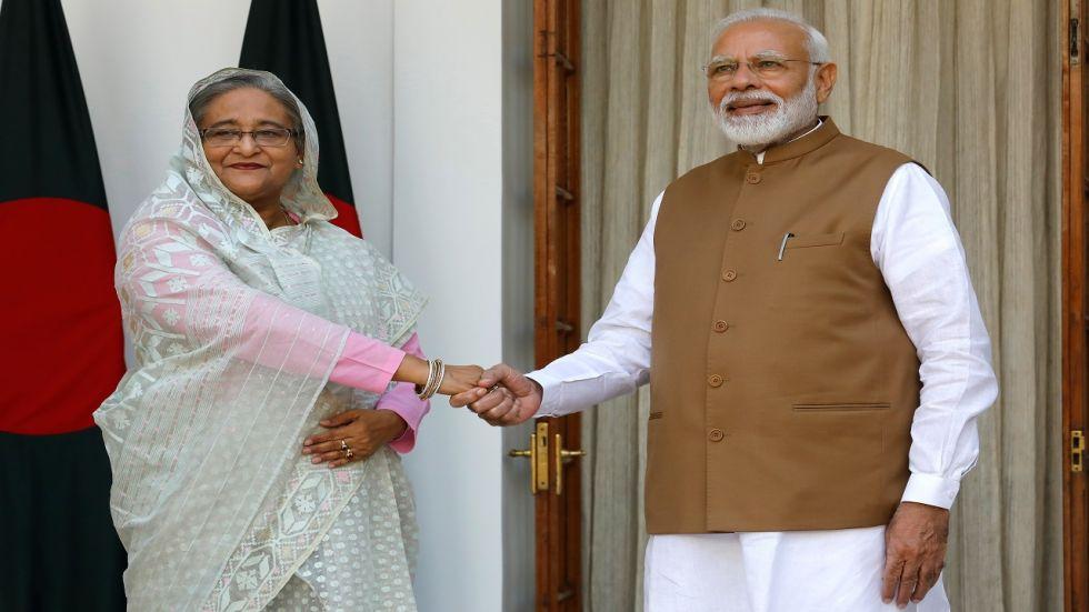 India's PM Narendra Modi meets his Bangladeshi counterpart Sheikh Hasina at Hyderabad House in New Delhi.