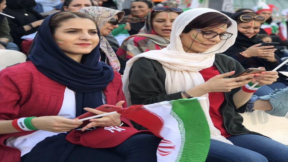 Waving flags and snapping selfies, thousands of Iranian women on Thursday attended a football match freely.