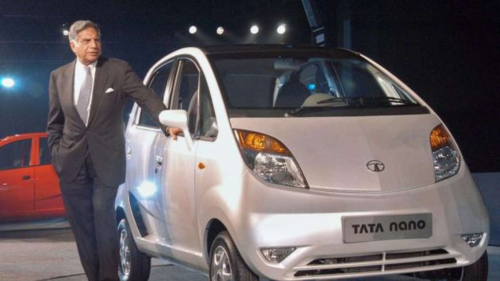 Ratan Tata with his dream car Tata Nano.