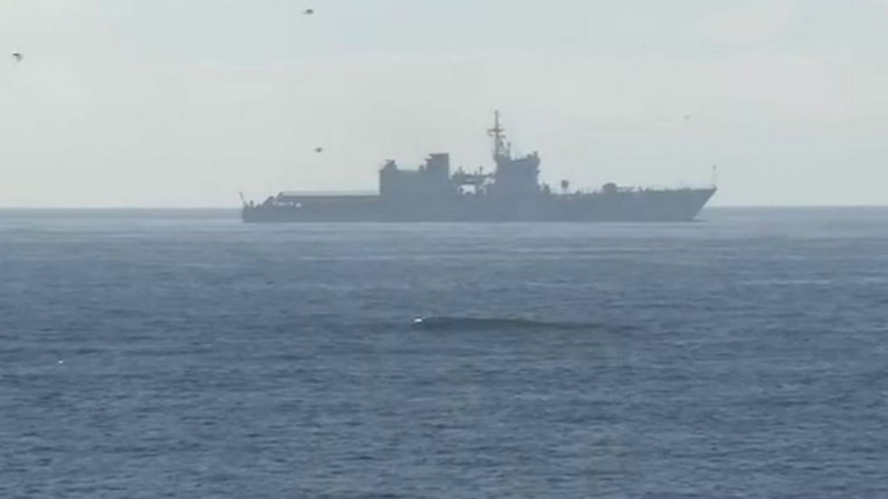 Warships have been deployed at some distance from shore to provide security from any seaborne threat