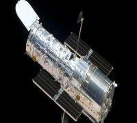 NASA, ESA's Hubble Telescope Snaps Image Of Spiral Galaxy 60 Million Light-Years Away