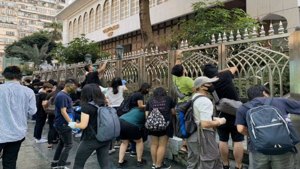 Protesters have labelled the attacks 'white terror' and accused the city's shadowy organised crime groups of forming an alliance with Beijing supporters.