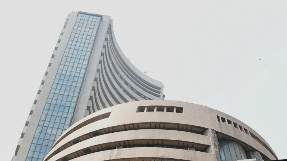 Sensex surged over 293 points to hit its record intra-day high