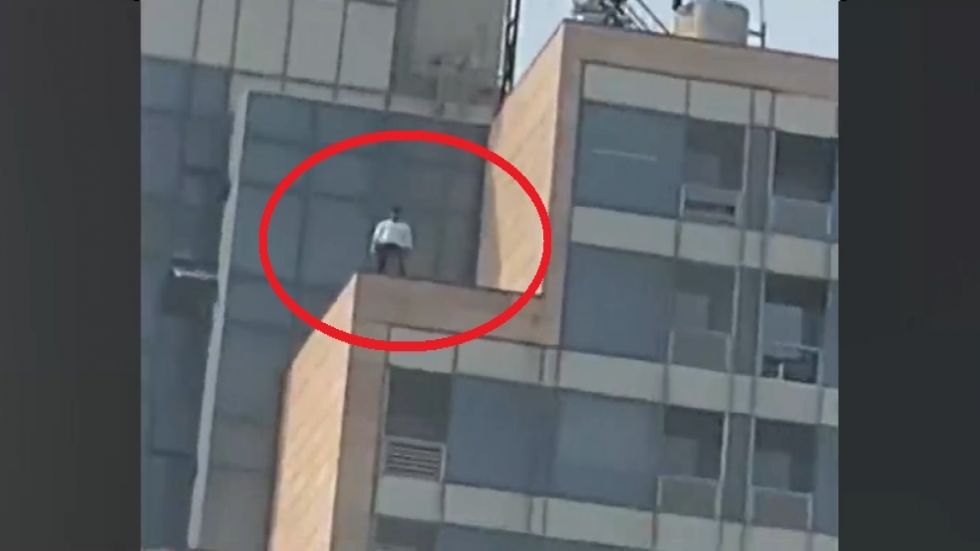 In a video available with News Nation, the lawyer is seen standing on the roof top of the building.