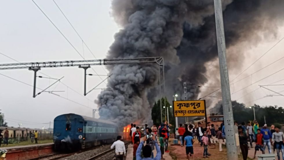 Several empty trains standing at the Krishnapur railway station in Murshidabad district were set on fire