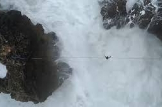 Daredevil falling off a highwire and being engulfed by a giant wave