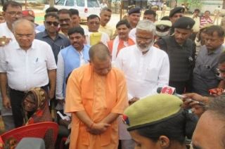 UP CM Yogi Adityanath meets victims' family members in Sonbhadra